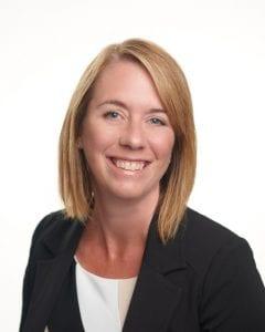 Ms. Jennifer Figner, smiling.