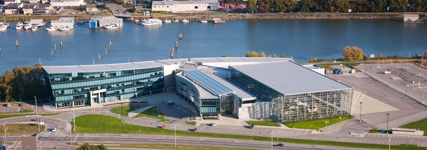 Aerial view of the Aerospace Technology campus building and hangar.